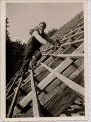 Thumbnail of Photograph: Klagenfurt, Austria, (probably 1944), Yurii Fedechko building a roof.