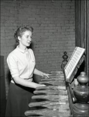 Thumbnail of Orton Hall, The Ohio State University: Interior view of woman playing chimes