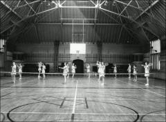 Thumbnail of Pomerene Hall, The Ohio State University: Interior view of gymnasium with women's tennis class