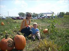 Thumbnail of Photograph: Delaware, Ohio, 2008, Olena Dyedukh and Nels Carlson at Pumpkin Festival.