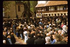 Thumbnail of Mourners outside the church hall and the church