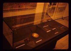 Thumbnail of Several archeological finds in a glass case at the exhibit