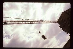Thumbnail of Crane lifting concrete