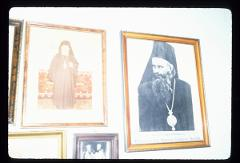 Thumbnail of Preobraženje (Transfiguration) Monastery -- photographs of clerics on the the wall of the conference room