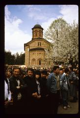 Thumbnail of Funeral attendees outside the church