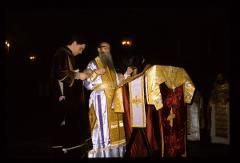 Thumbnail of Patriarch being vested for the service 'Ordination of a Deacon'