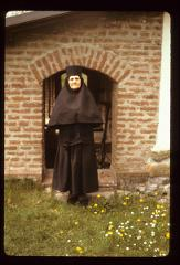 Thumbnail of Sister Ana at church entrance