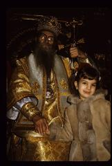 Thumbnail of The Patriarch with a young girl parishioner