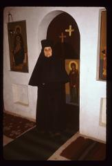 Thumbnail of Sister Ana in front of altar doors