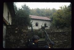 Thumbnail of Dević monastery, Kosovo -- exterior view of the monastery with two soldiers