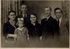 Thumbnail of Photograph: Family portrait, 1949, Munich, Germany, Alexandra Klaudia Melnyk (nee Alexandra Klaudia Yezerska); Konstantin Melnyk; Arkadia Melnyk; Anna Yezerska (nee Anna Bihun); Konstantin Yerezsky; Zenon Yerezsky