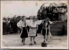 Thumbnail of Photograph: Dancing number at camp performance, 1948 (or 1949), Stephanskirchen, Germany, Magda Kolcio (nee Ostapiuk)