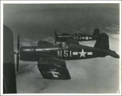 Thumbnail of John Glenn flying his VMF-155 Corsair, 1943