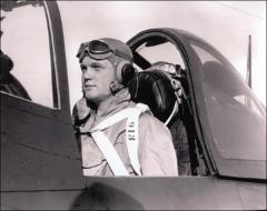 Thumbnail of John Glenn in the cockpit of an F4U Corsair