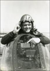 Thumbnail of John Glenn pointing to damage to his F9F Panther from antiaircraft fire