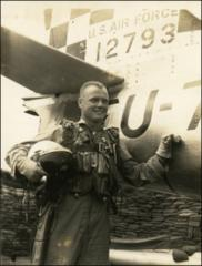 Thumbnail of John Glenn standing beside his F-86 Sabre