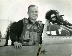 "Thumbnail of John Glenn in the cockpit of his ""MiG Mad Marine"""