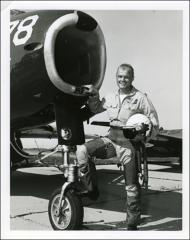 Thumbnail of John Glenn standing beside a jet aircraft at the U.S. Navy Test Station at Patuxent River, Maryland