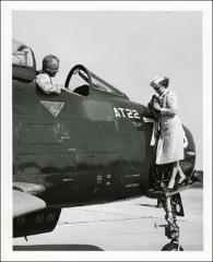 Thumbnail of John Glenn sitting in the cockpit of a jet aircraft at the U.S. Navy Test Station at Patuxent River, Maryland