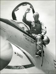 Thumbnail of John Glenn standing outside the cockpit his F8U-1P Crusader