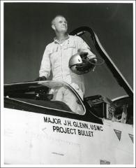 Thumbnail of John Glenn standing in the cockpit his F8U-1P Crusader