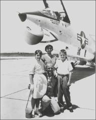Thumbnail of John Glenn with his family in front of the F8U Crusader, 1957