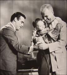 "Thumbnail of John Glenn receives a hug from Eddie Hodges after winning on ""Name That Tune"""