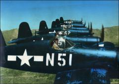 Thumbnail of John Glenn flying an F4U Corsair in formation with other pilots, circa 1944