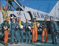 Thumbnail of The seven Project Mercury astronauts dressed in flight gear