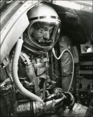 "Thumbnail of Project Mercury astronaut Alan Shepard peers out of his ""Freedom 7"" spacecraft"