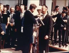 Thumbnail of Alan Shepard receives a medal from President Kennedy