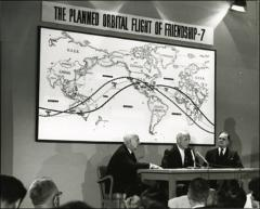 Thumbnail of Astronaut John Glenn with NASA officials Robert Gilruth and James E. Webb during a press conference