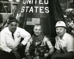 Thumbnail of John Glenn poses in front of Friendship 7 with T.J. O'Malley of General Dynamics and Paul Donnelly of the McDonnell Aircraft Corporation