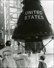 Thumbnail of Project Mercury spacecraft being lifted to top of gantry