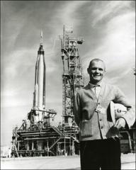 Thumbnail of John Glenn in front of Friendship 7 spacecraft and Atlas rocket booster