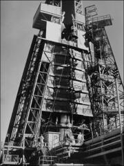 Thumbnail of Friendship 7 being hoisted on top of its Atlas rocket