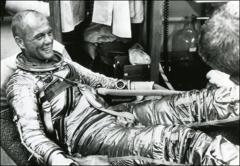 Thumbnail of John Glenn relaxes in his space suit