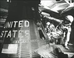 Thumbnail of John Glenn climbs into Friendship 7