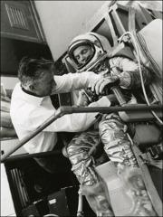 Thumbnail of John Glenn goes through a pressure check on his spacesuit