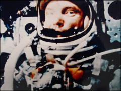 Thumbnail of John Glenn in space, looking at on-board camera