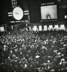Thumbnail of Commuters in Grand Central Station watch the launch of Friendship 7