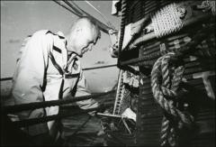 Thumbnail of John Glenn inspects his spacecraft following his orbital space flight