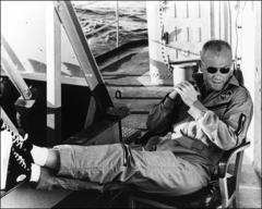 Thumbnail of John Glenn relaxes aboard the U.S.S. Noa