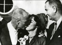 Thumbnail of John Glenn greets his wife, Annie Glenn, as Vice President Lyndon B. Johnson looks on