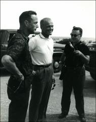 Thumbnail of Astronauts Scott Carpenter and John Glenn talk to reporters