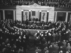 Thumbnail of John Glenn receives a standing ovation during his speech to a special joint session of Congress