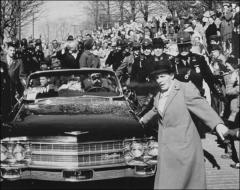 Thumbnail of John and Annie Glenn ride through the crowds lining the street during the New Concord, Ohio parade