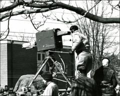 Thumbnail of A television camera broadcasts the New Concord, Ohio parade honoring Glenn's Friendship 7 flight