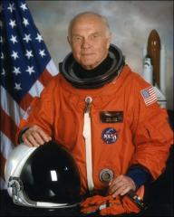 Thumbnail of Formal portrait of John Glenn in his spacesuit as a crew member on the Space Shuttle Discovery