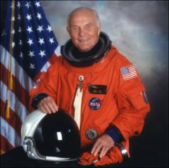 Thumbnail of Formal portrait of John Glenn smiling while wearing his spacesuit as a crew member on the Space Shuttle Discovery